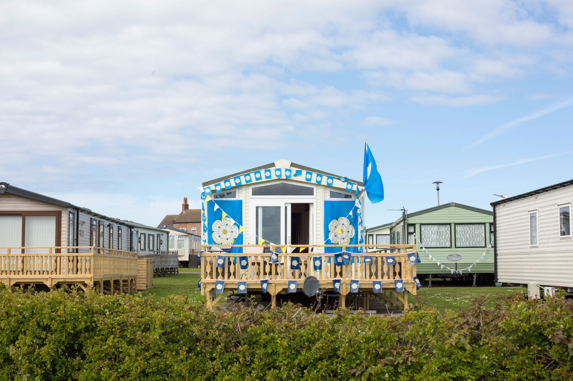 Tour De Yorks bedecked static caravan.