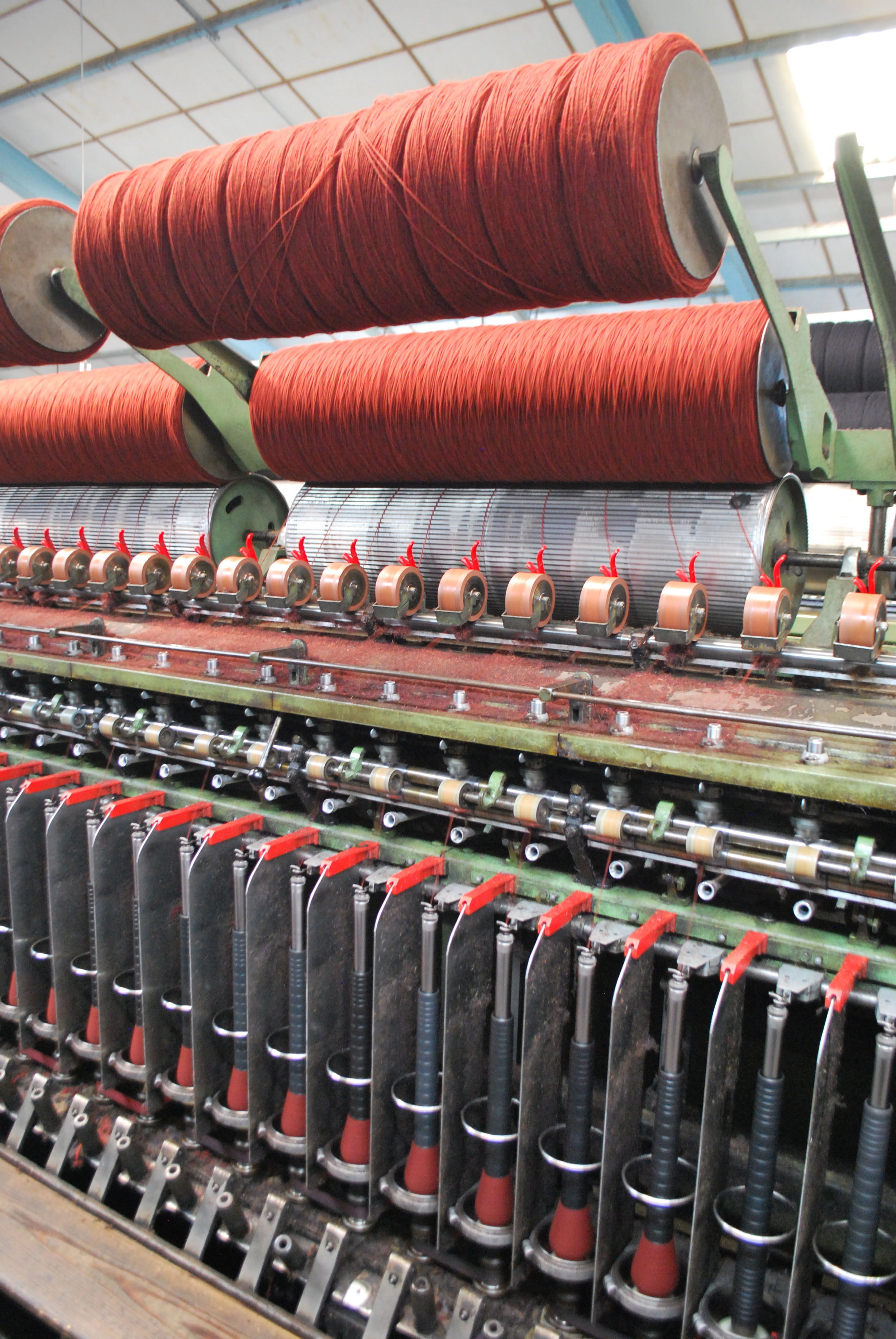 The yarn is being spun onto the bobbins.