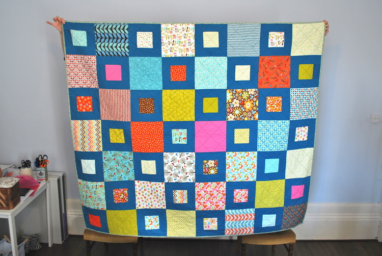 The Sweetie Box quilt by one of our students from a previous course.