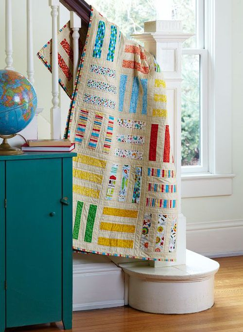 A traditional Rail Fence quilt, created by April Lahoda.