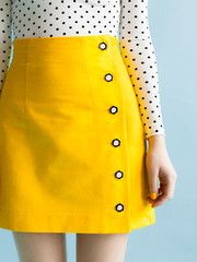 ARIELLE  Tilly & The Buttons  Arielle is an asymmetric pencil or mini skirt with an adorable button opening to one side. Long darts and a high waistline create a flattering, figure-hugging shape. The unlined version is an ideal project for confident beginners, or take your sewing prowess up a notch by adding the optional luxury lining.