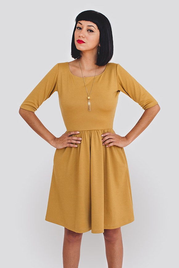 MONETA DRESS  by Colette Patterns  Built for both elegance and comfort, this simple knit dress works in every season and for any occasion.  All three styles of Moneta dresses have a gently curved, wide neckline, a fitted bodice, and a shirred skirt with in-seam pockets. Version 1 is a sleeveless dress with a lined bodice and narrow round collar that laps at the center back. Version 2 has an unlined bodice and short sleeves, while version 3 has an unlined bodice and 3/4-length sleeves.