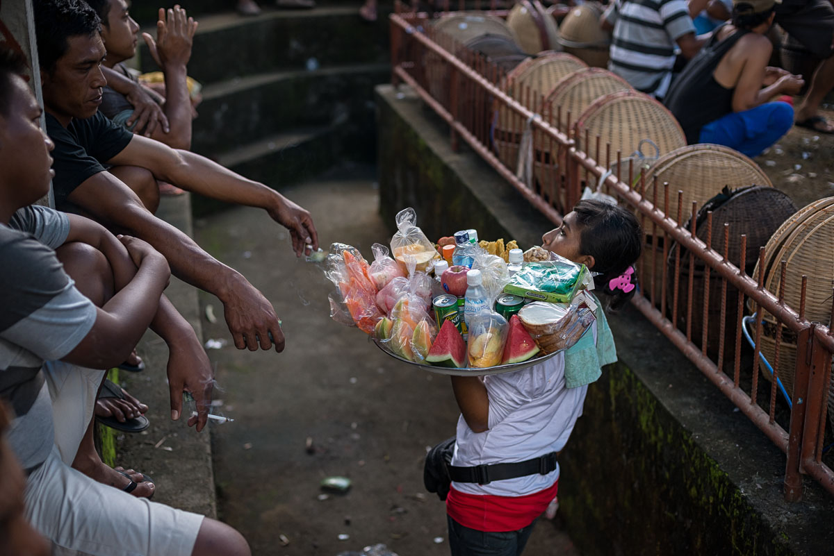 Woman selling small refreshments and food