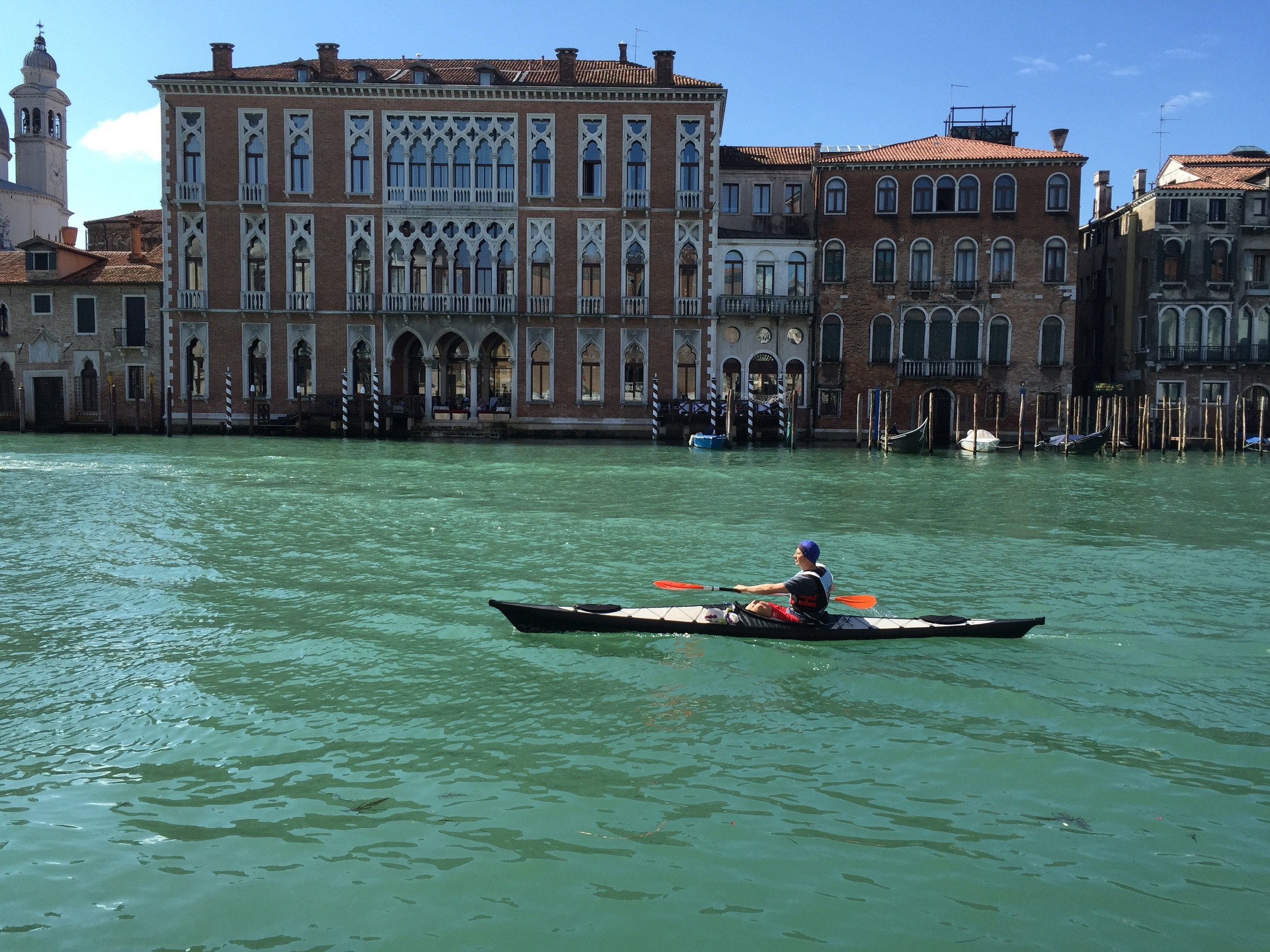 Watching other people exercise at  La Vogalonga,  Venice's famous boat race.
