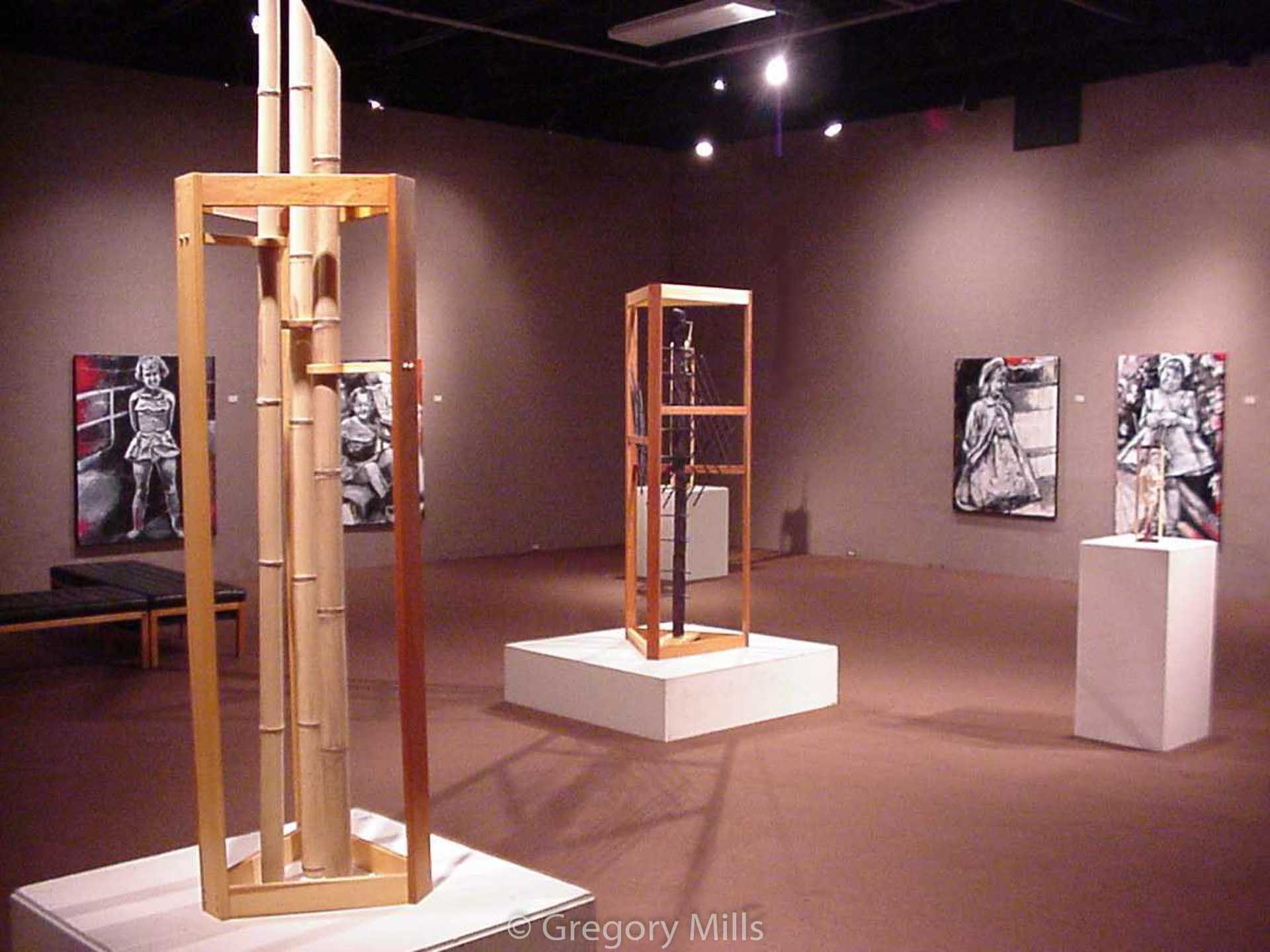 Photos of Exhibit of sculptures by Gregory Mills and paintings by another artist. This is his oldest digital photo from 1999 and a whopping 1.1 megapixels.