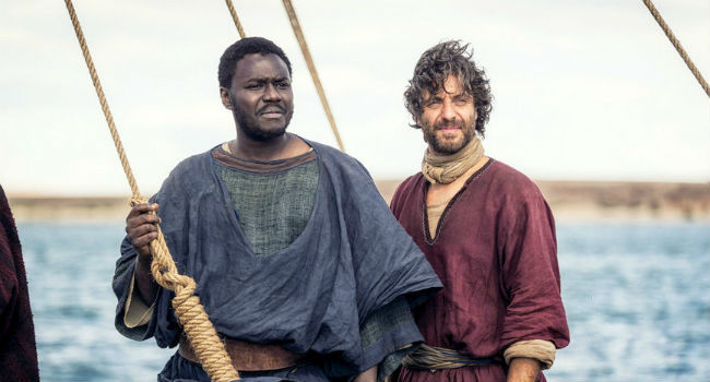 John (Babou Ceesay) and Peter (Matthew Levy) look to a strange figure on the shore... (Hint: it's Jesus.)