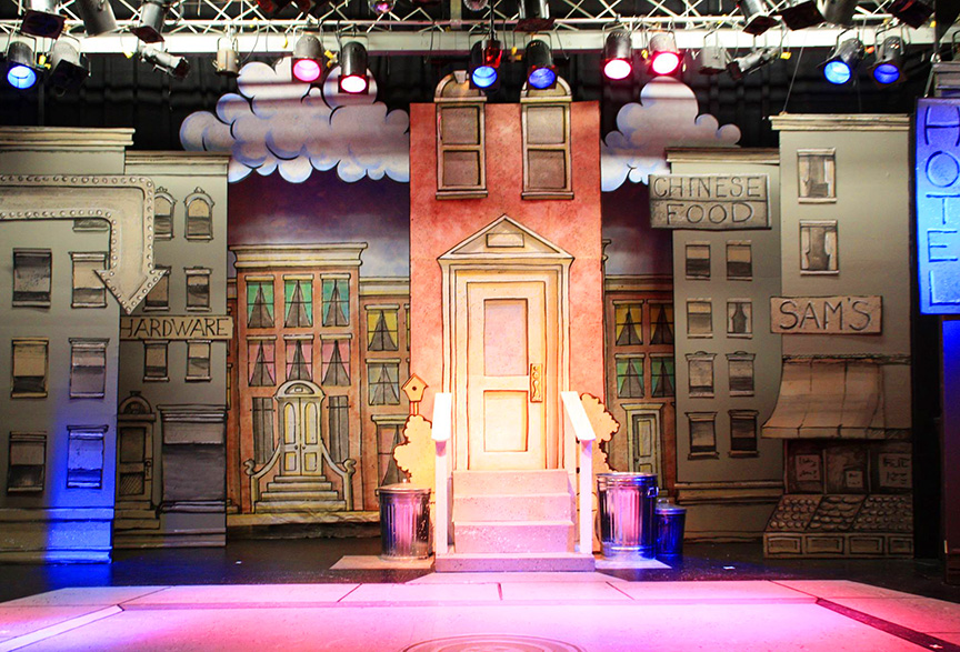 The Growing Stage's set for the stage adaptation of   KNUFFLE BUNNY: A Cautionary Tale  by Mo Willems.    KNUFFLE BUNNY: A Cautionary Musical ,   script and lyrics by  Mo Willems  and   music by  Michael Silversher. Set design by Perry Kroeger.