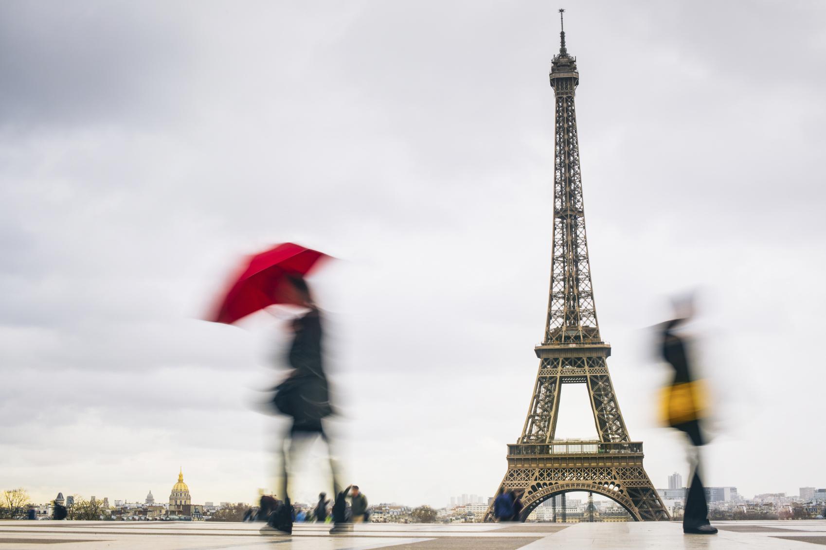 women in france eiffel tower on rain day