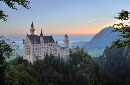 Bavarian castle Neuschwanstein in the Alps shortly before sunrise - goinginstyle.org