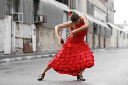 Female flamenco dancer in dancing pose in Spain