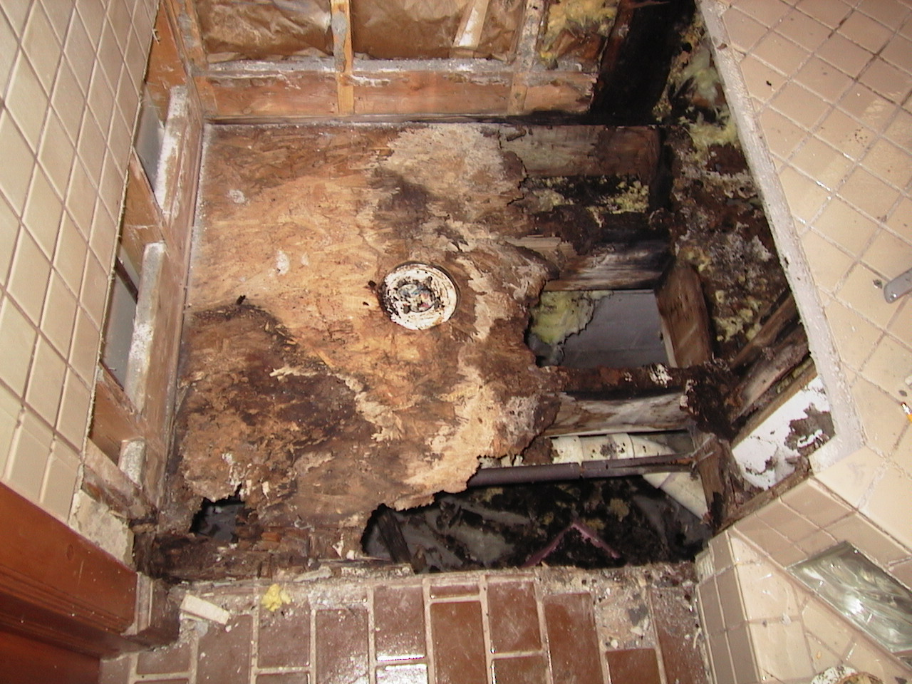 Water ran behind the shower membrane and into the sub floor.
