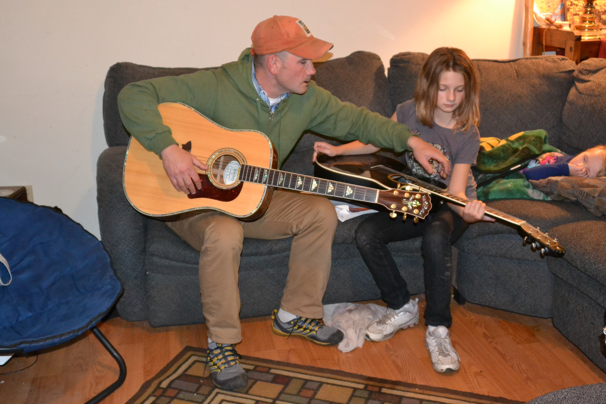 Guitar Lesson  by  Tony Alter,   Attribution 2.0 Generic