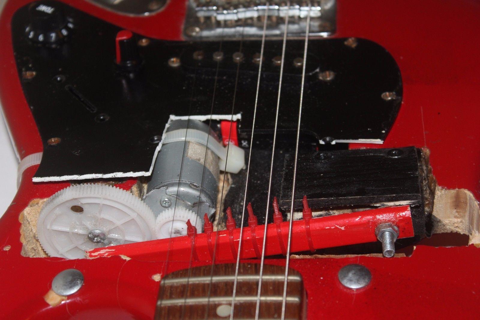 Self-strumming guitar 02.jpeg