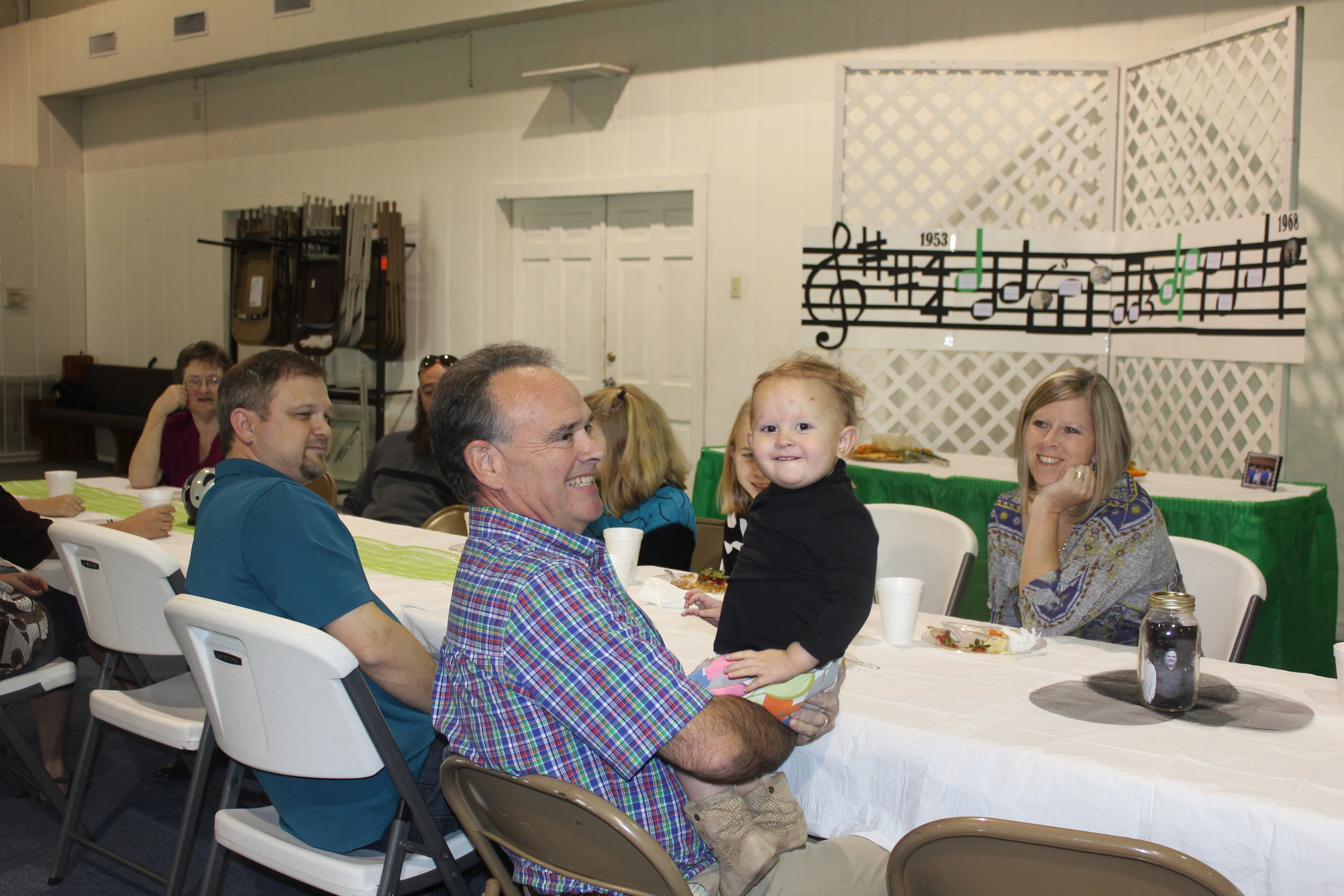 Dad, holding Kenzie and sitting with the Youth Pastor he worked with at FBC Pearsall!