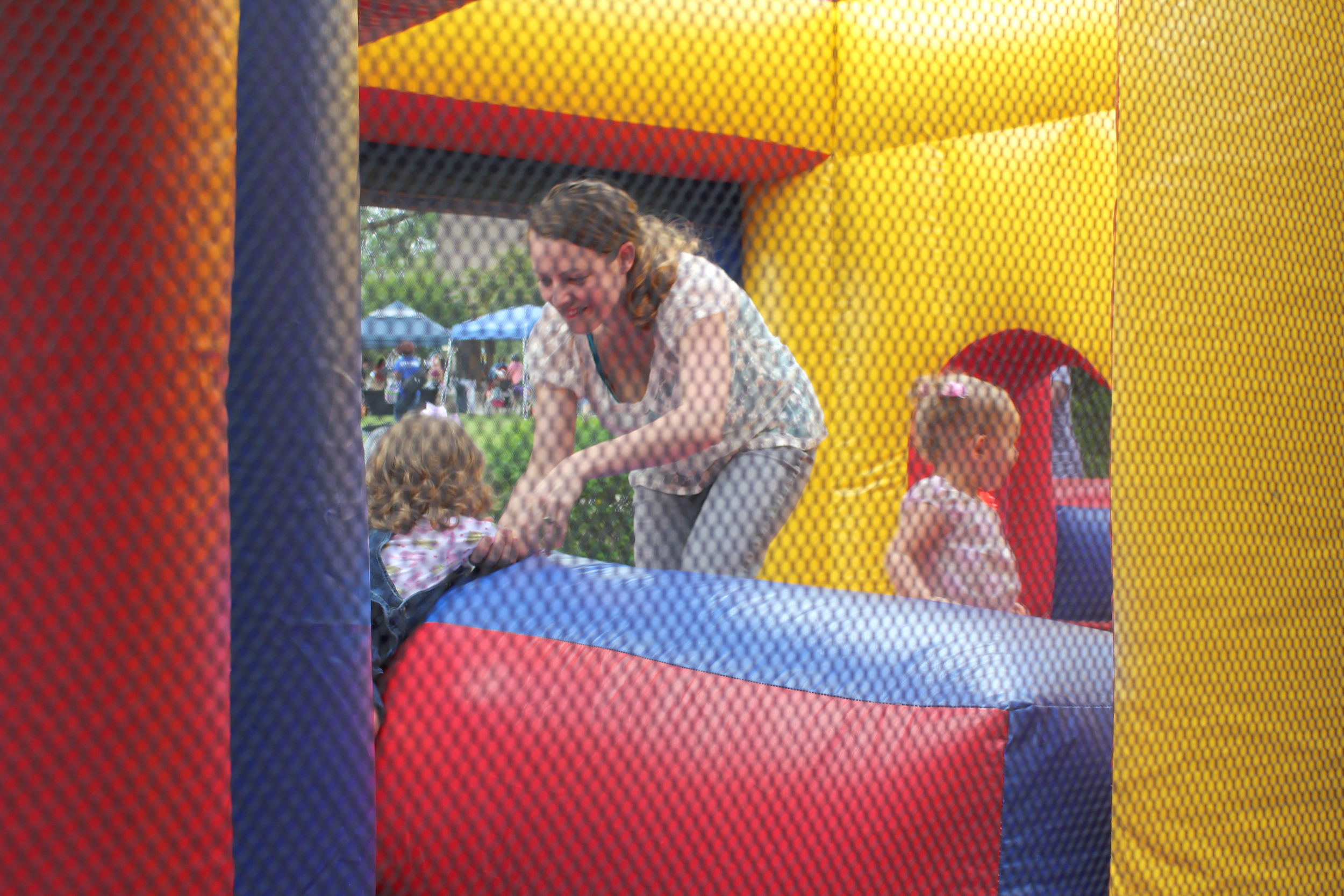 Avi, me, and Kenzie in the bounce house.