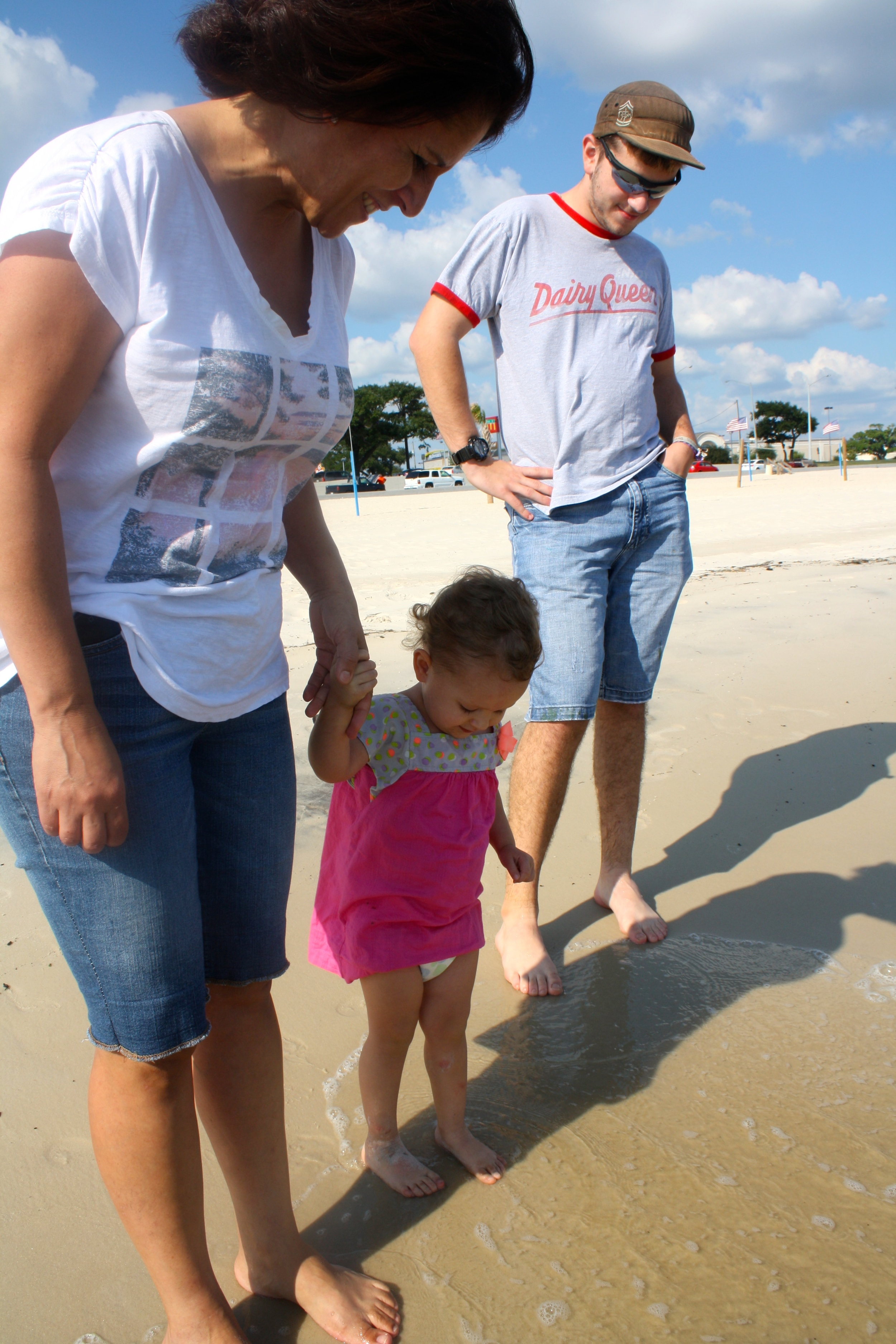"""Mimi and Uncle Caleb lent courage to Kenzie in her first ocean """"toe-dipping""""."""