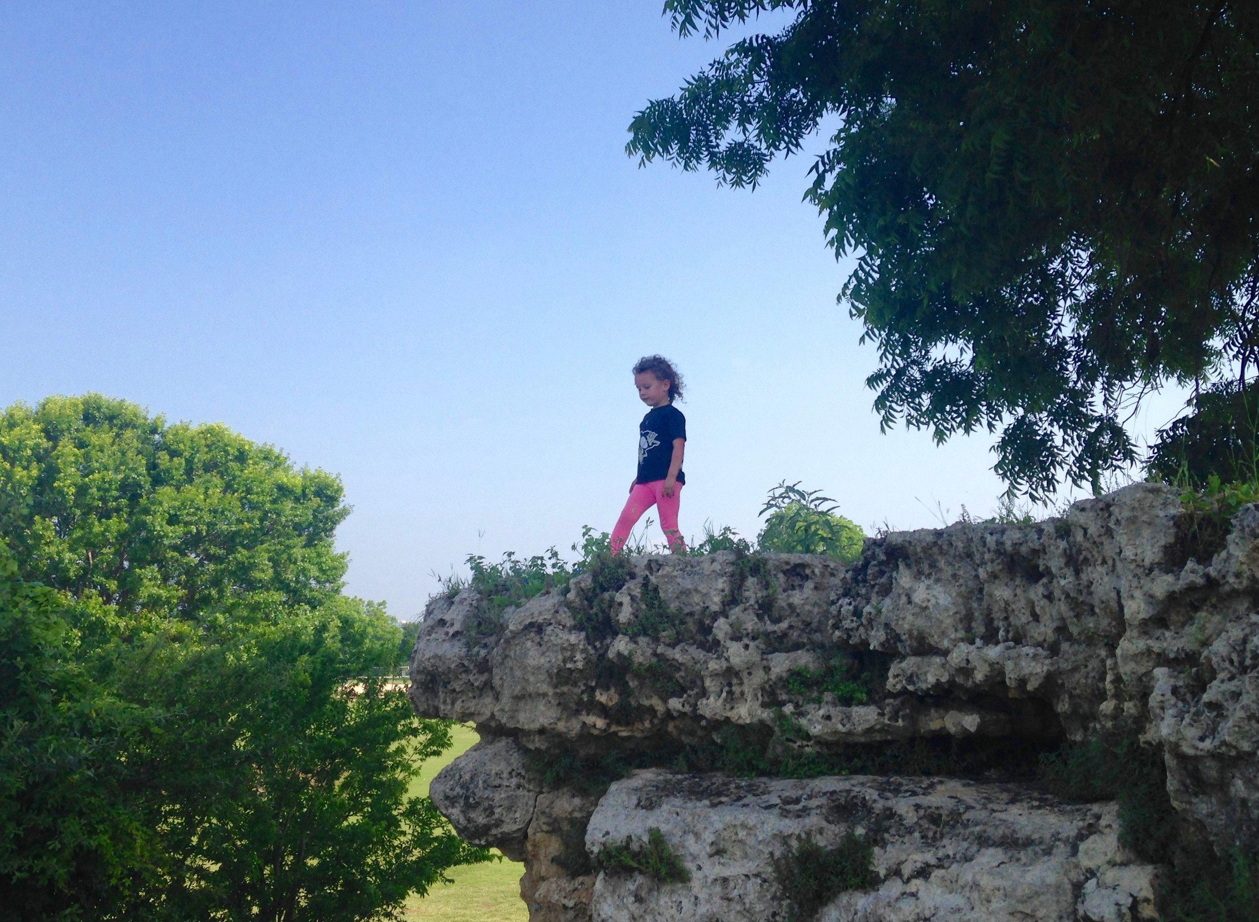 Kenzie, scaling the limestone cliffs in Zilker Park, downtown Austin.