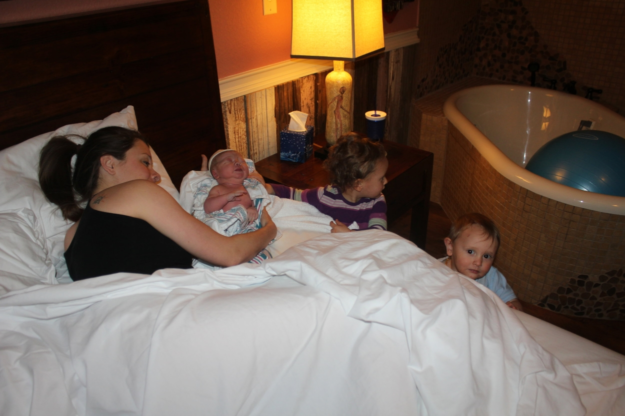 Kenzie and Judah meeting Olivia (third-born)for the first time. She and Cora share a birthing room.