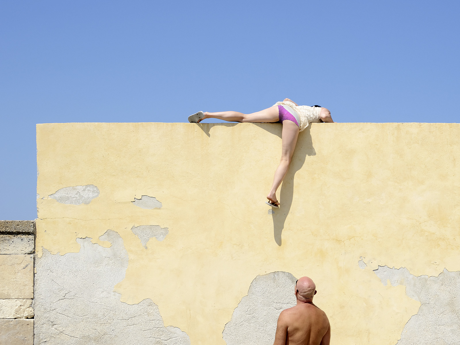 """The image """"Bald Look"""" was taken in Sicily during our honeymoon. My wife attempted to climb off of the harbor wall when she was spotted by a Polish tourist. The photograph will be on display during this year's APA SF Something Personal exhibition on Wednesday, November 4, 2015 from 5PM to 11PM. Please RSVP if you would like to come to the show.  The venue:  THE MIDWAY GALLERY, 900 MARIN STREET, SAN FRANCISCO"""