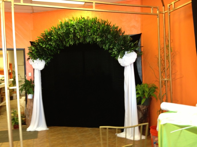 The   Arch   is 9' x 9' and includes silk greens and chiffon in assorted colors.