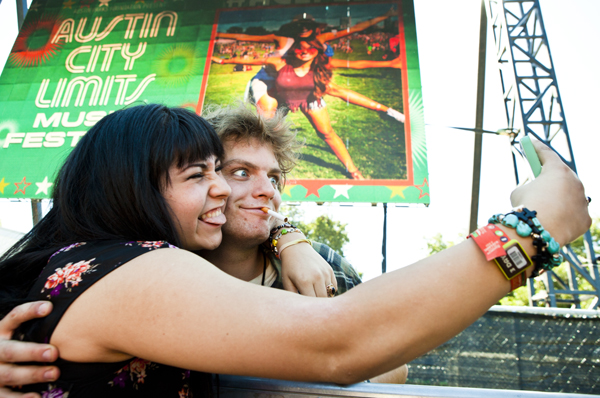 Mac DeMarco and fan shoot a duet selfie after his performance at ACL Music Festival.