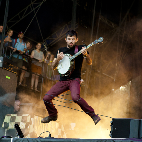 Scott Avett of  The Avett Brothers  gets some banjo air at ACL Music Festival 2014. Don't worry ma ... I'm tethered.