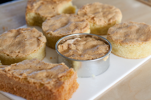 Cutting rounds of almond cake with pastry cutters