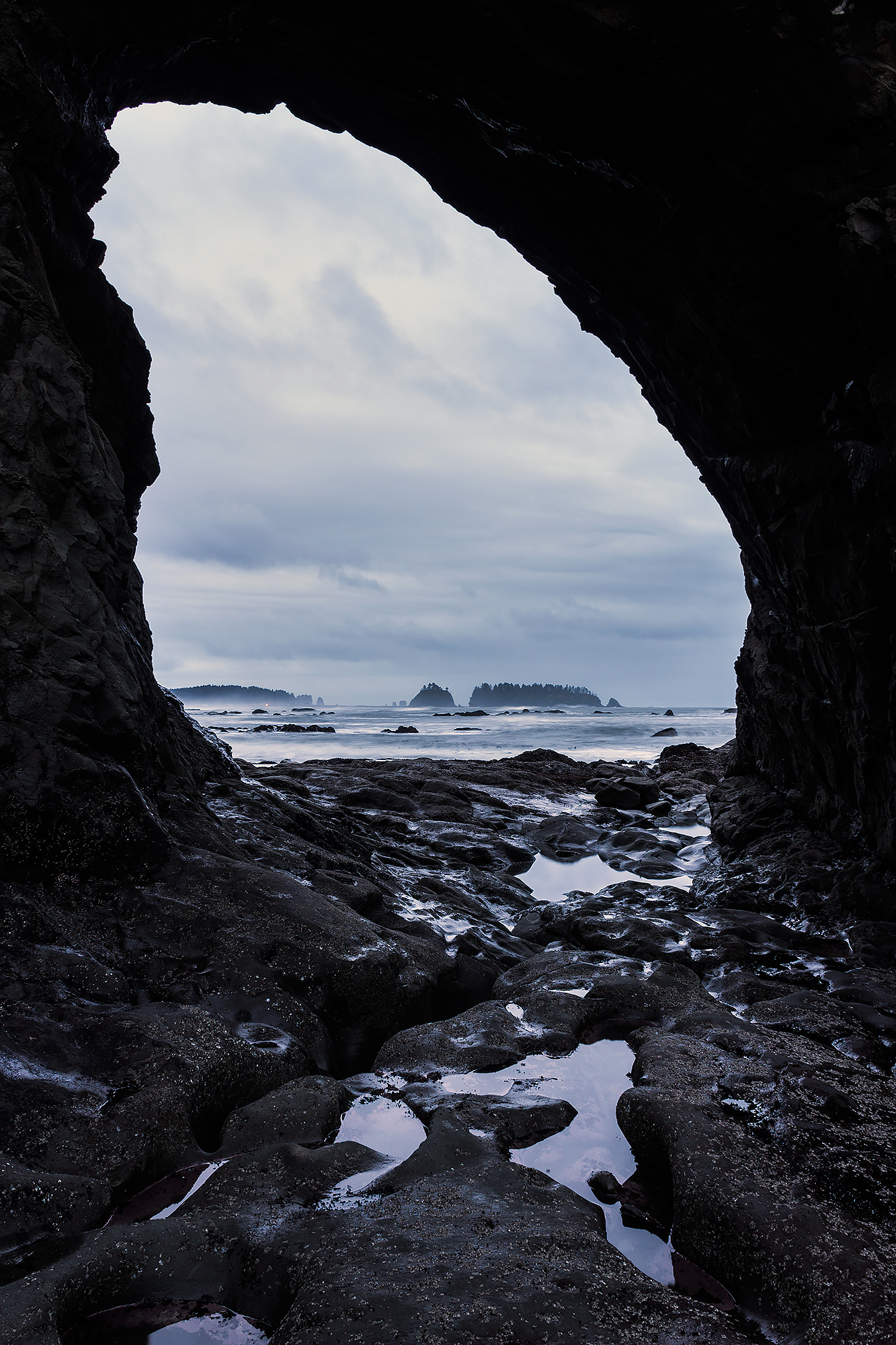 Hole in the wall, a natural tunnel formation on Rialto Beach near La Push, WA.