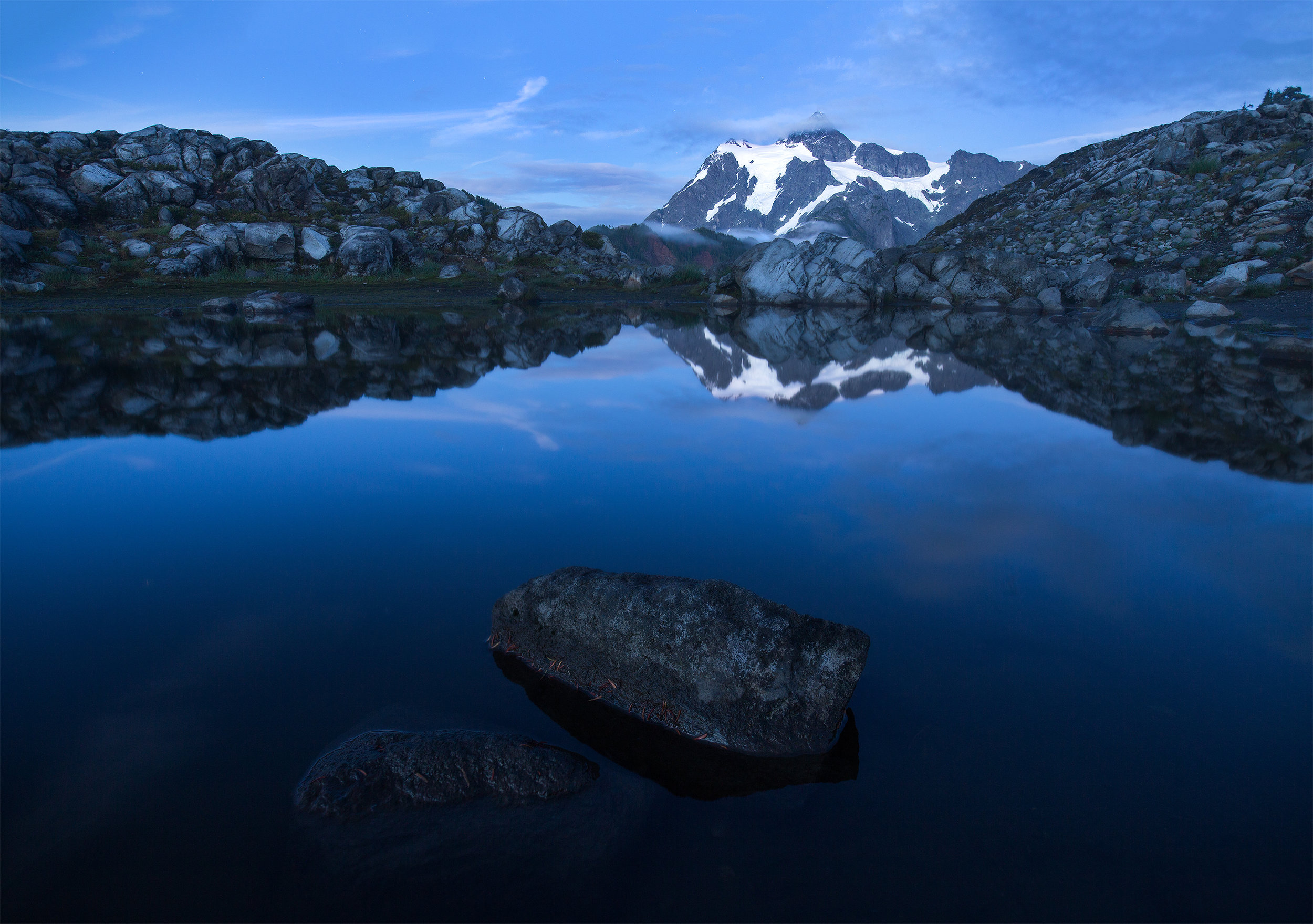 Mount Shuksan during blue hour, reflected in a pond near Arist Point.