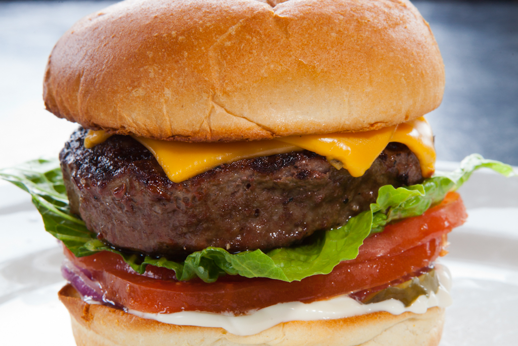 Rossi burger  A variation of our famous Club 185 cheeseburger; lettuce, onion, tomato, pickle, mayonnaise