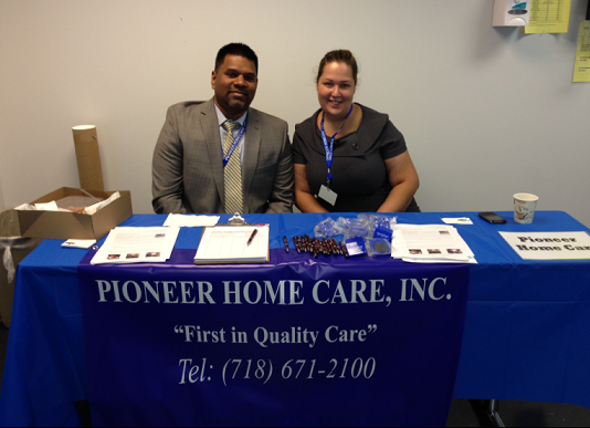 Chris Kovoor and Ebony Soto representing Pioneer Home Care, Inc. at the  Job and Transition Fair