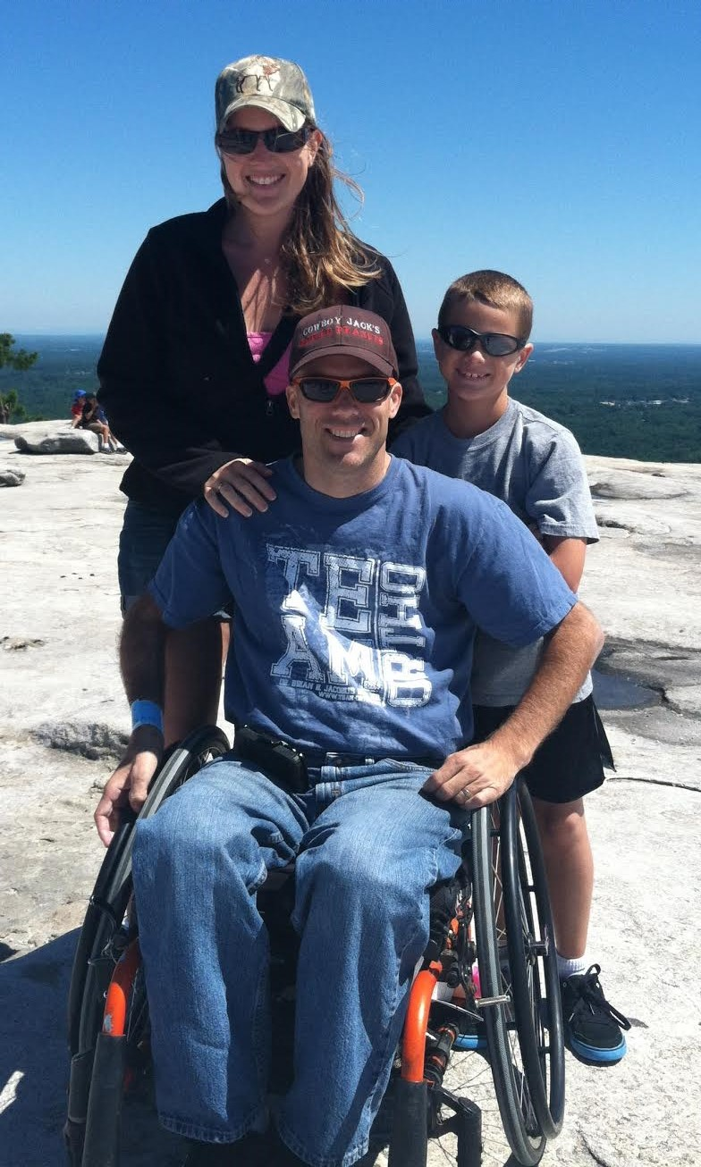Jason and Laura Dugmore with their son on Stone Mountain, Georgia