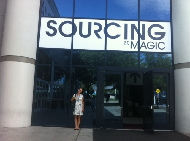 "Standing in front of the ""Sourcing"" exhibit"