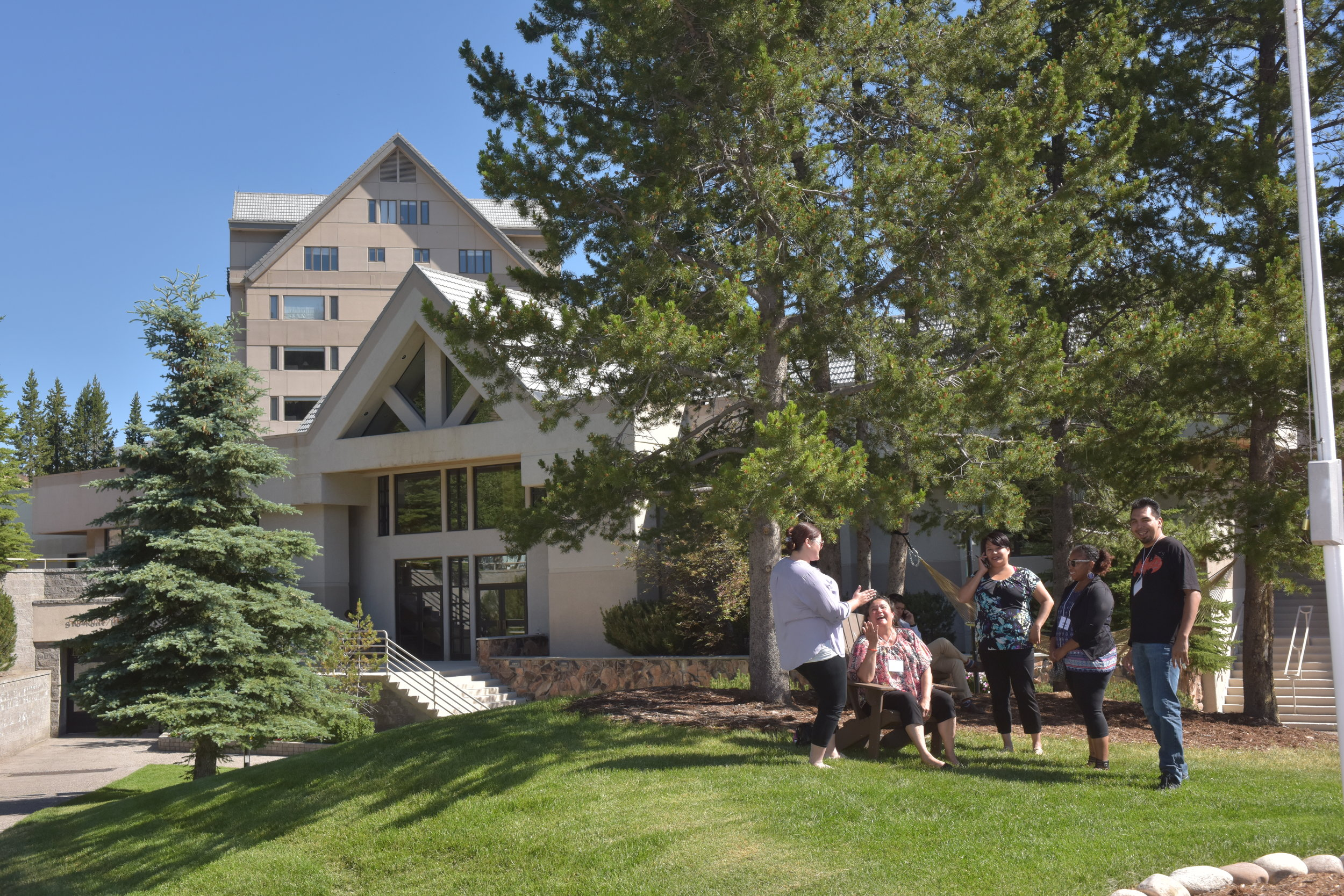 2017 participants talk outside the yellowstone conference center at big sky resort.