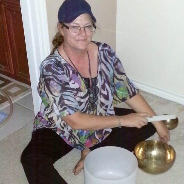 Shar plaing the crystal bowls