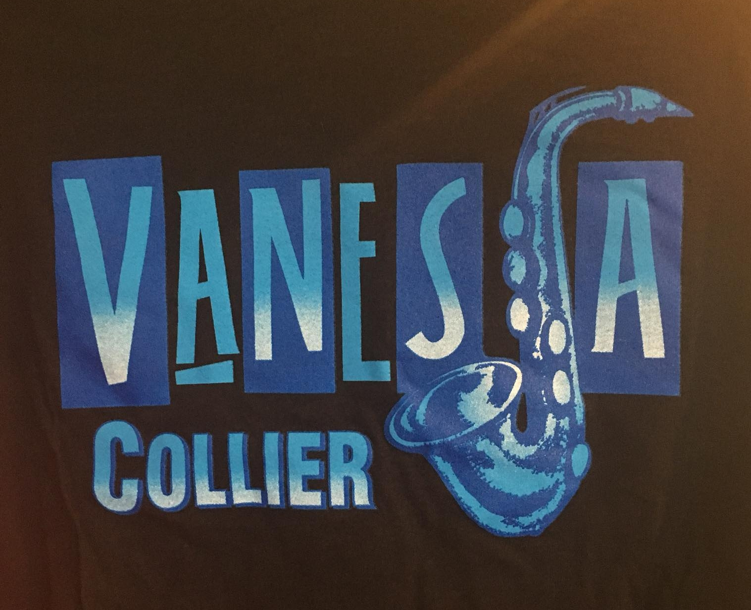 *NEW* OFFICIAL VANESSA COLLIER T-SHIRT DESIGN BY THE INCREDIBLE MIKE MCCARTY!! This t-shirt is black with two shades of blue in the design and will be shipped out soon! Read up on Mike's album artwork for the   Atlanta Rhythm Section, Jerry Lee Lewis, Isaac Hayes, James Brown, Waylon Jennings, Willie Nelson, Patti Smith, KC and the Sunshine Band, Billy Joe Royal, Albert Coleman and The Atlanta Pops Orchestra, Bobby Brown/Whitney Houston, etc.    here !