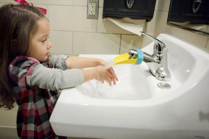 SUS 01 girl at faucet FB.jpg