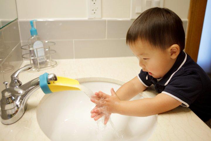 SUS 01 boy at faucet FB.jpg