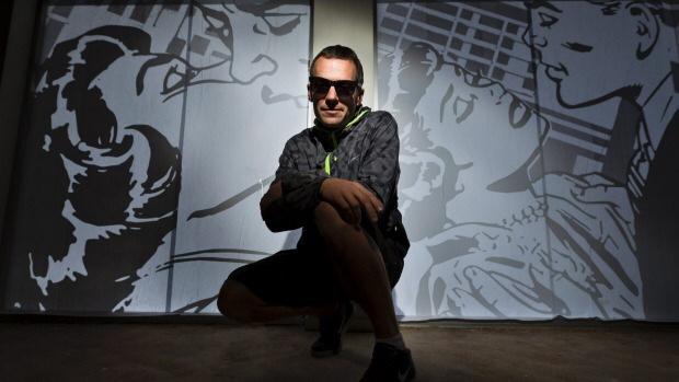 Graphic artist Klaasz Breukel with his window display on Bridge Street. Alden Williams/Fairfax NZ