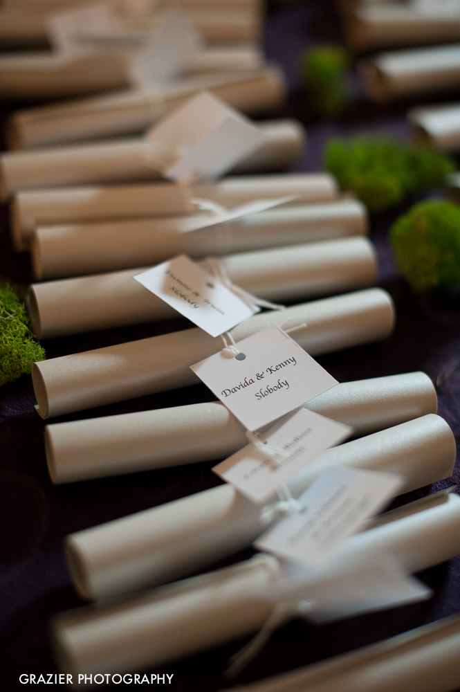 """We witnessed one of the CLASSIEST things in our whole career as wedding photographers at Rob and Danielle's wedding. The place-card table contained row upon row of rolled up scrolls of paper for each guest and couple. We see pretty paper things like this quite often, so we didn't put much thought into what the inside might look like until we saw the guests entering the cocktail reception, hands on  hearts, wiping tears from eyes, sharing their scrolls with each other in wide-eyed wonder. Each scroll was a personal hand-written note from the bride and groom. And it wasn't just a """"welcome to our wedding"""" message... it was personal and heartfelt, uniquely tailored to each person at the wedding. We were just floored when we considered the time and effort that went into writing each of these notes!"""