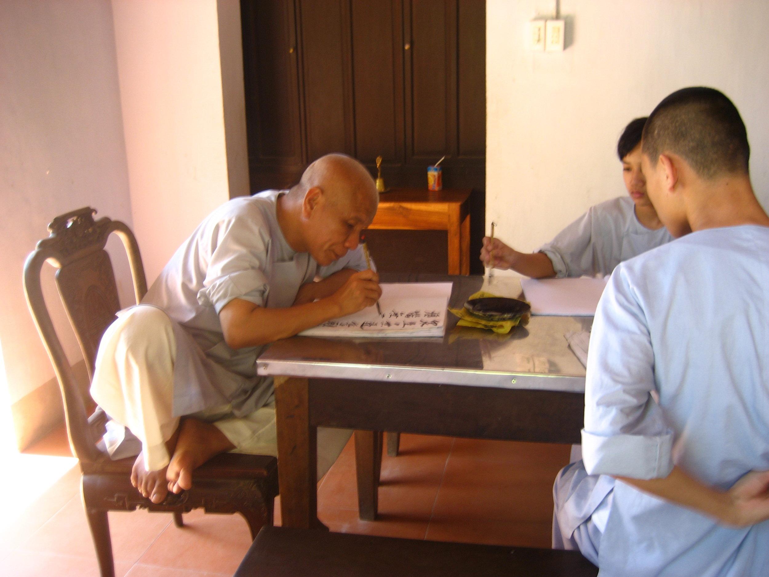 Monks hard at work, somehow ignoring stupid tourists.