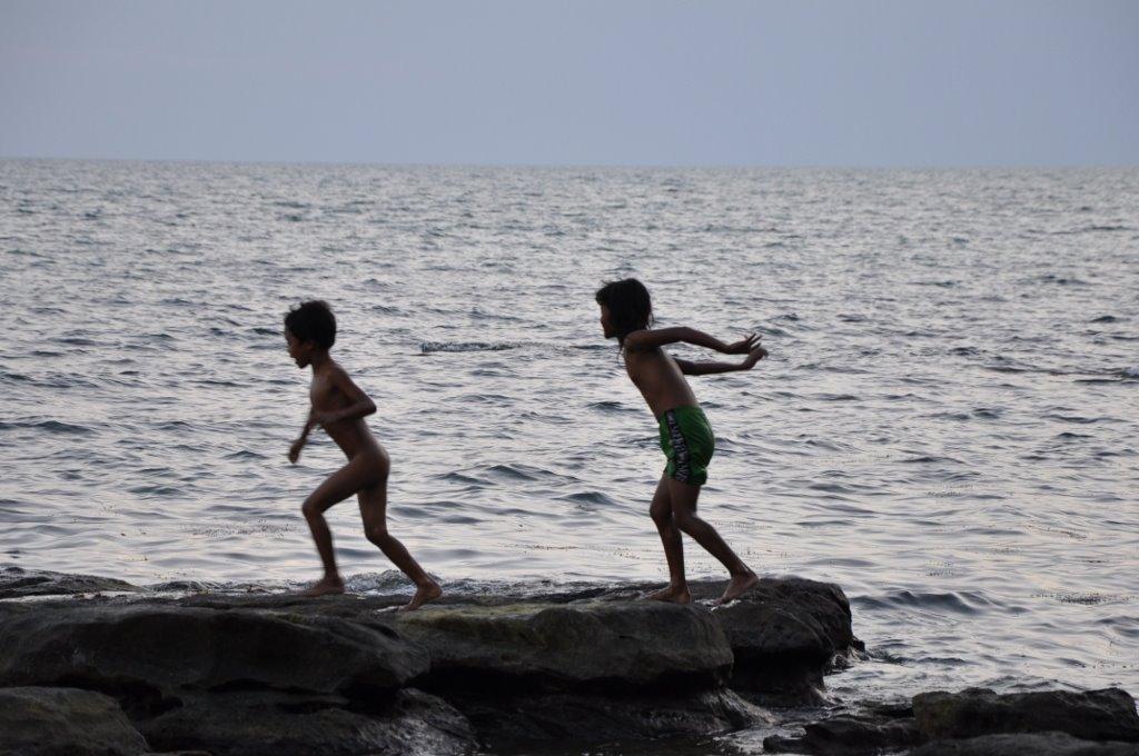 Kiddiwinkles playing on the rocks.