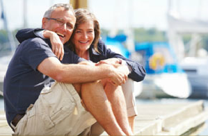 Retired couple on pier.png