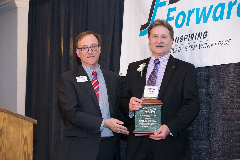 Jeffrey with award.jpg