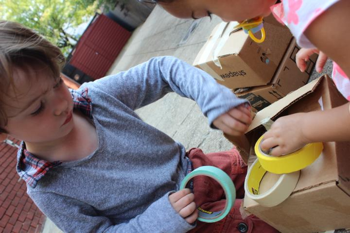 "We give children simple materials that can be combined to make projects of varying complexity, according to their skill and interests. We love boxes! They can become anything children want them to be!  We love tape!  As all children do . . . We present some of the same materials each week, so that children, if returning to our program, can become proficient in the many ""languages"" of expression available to them as creative human beings."