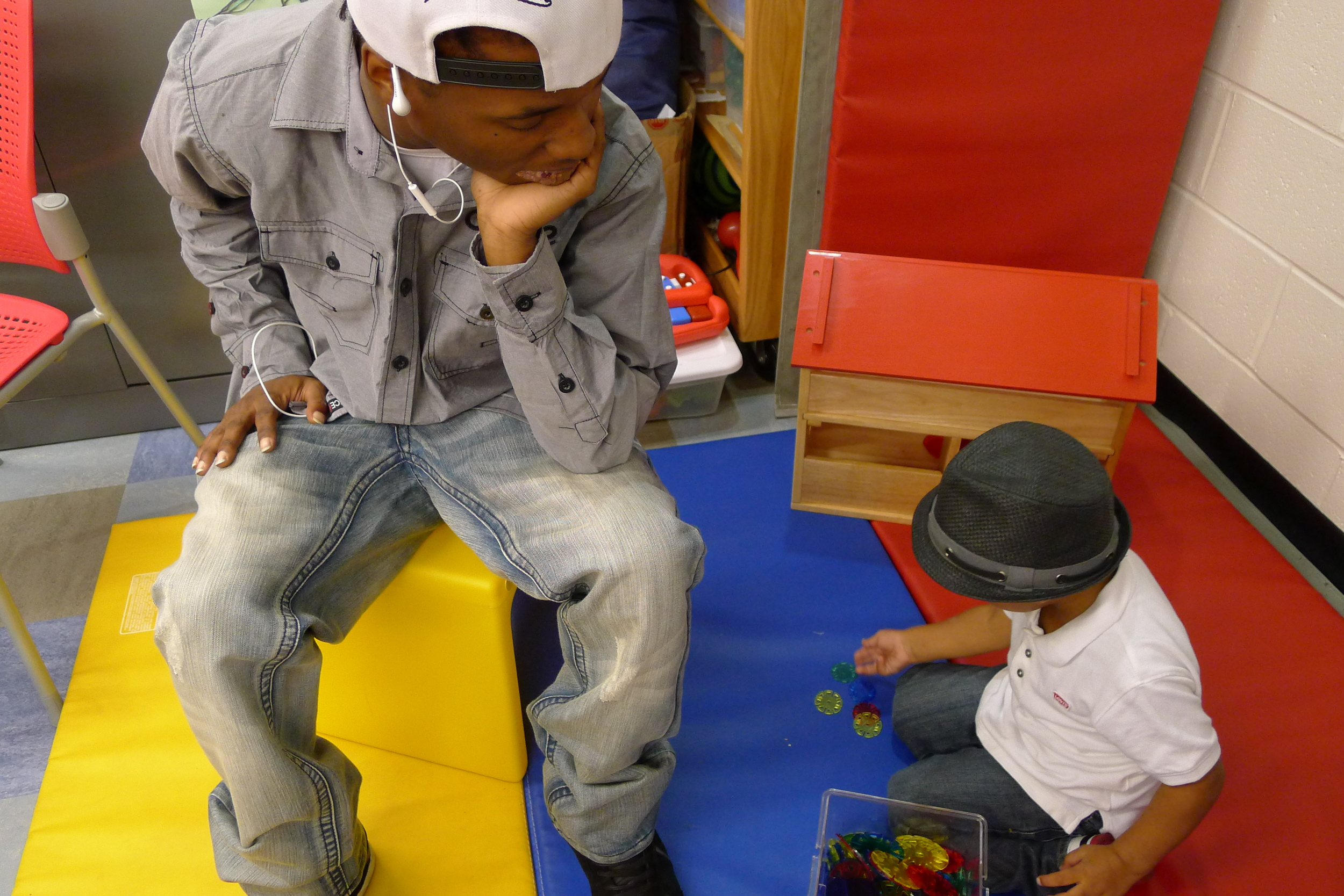 Rasheed of RHI looks on as his 2-year-old son plays, during our Sept round table meeting.