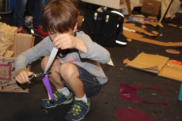 For anybody who has ever worked with duct tape or any kind of long strip of tape for that matter, it is NOT an easy material. But children of all ages on this day set out to work it out!