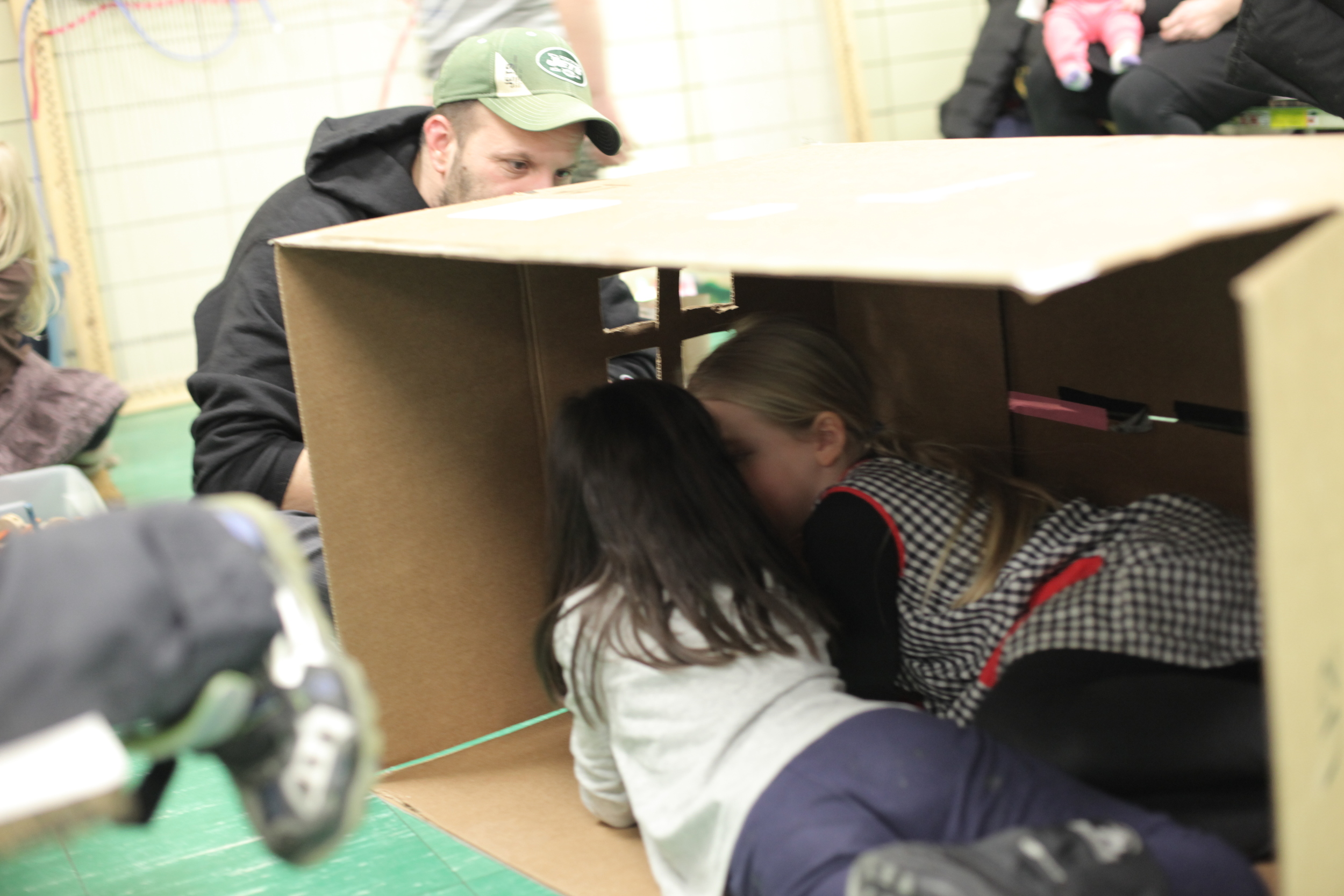 "A kind daddy cut windows in our cardboard ""house."""
