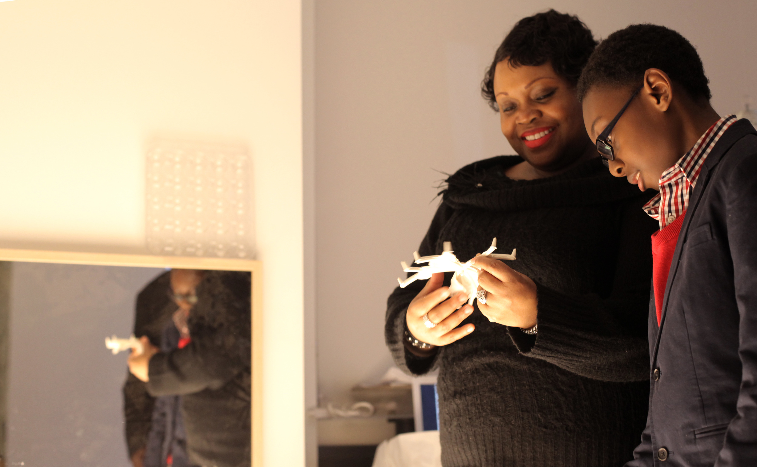 Nakoley Renville, principal of PS 208KE in Flatbush, Brooklyn, enjoys the Light Atelier with her son.
