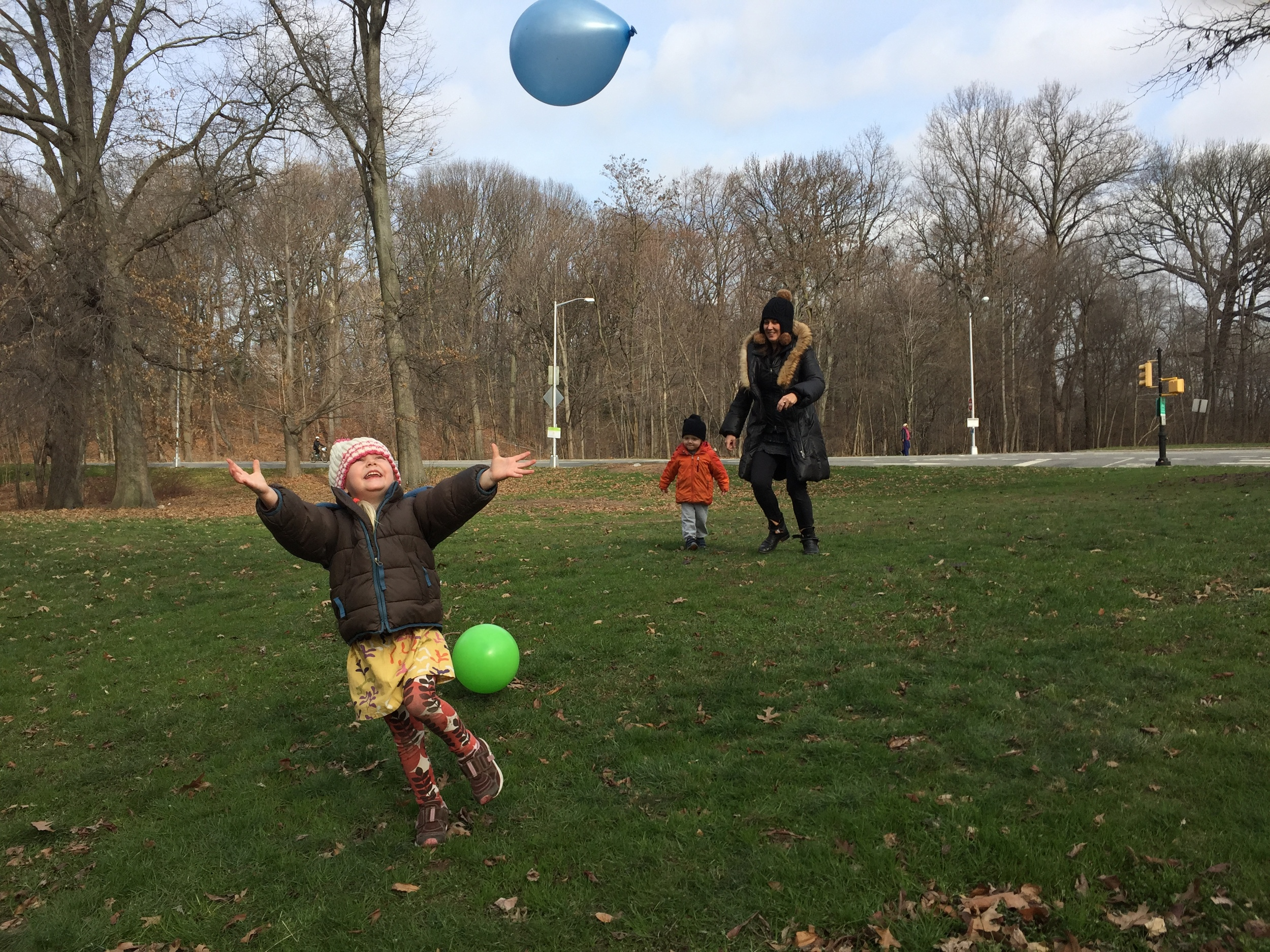 "Willow Nest's location allows frequent visits to Prospect Park. Founder Elisha Georgiou encourages children to play original stories. In this outside balloon-play scenario, the conversation between Elisha and her 3-yr-old students included these statements: ""Pretend I sended a note to you . . .  we're going to put a ice cream shop. . . we have ice cream with chocolate and bubblegum."""